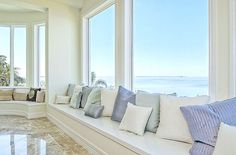 I would love my future vacation beach home to have this view and windows :)