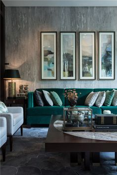 gray living room with emerald bue green velvet sofa Lots of beautiful room ideas with emerald or blue topaz color.