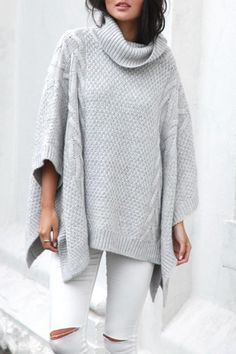 Oversized roll neck, cable knit poncho in grey. You will live in this poncho through the winter. Dress it up or dress it down and still look adorable and comfortable!