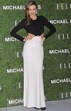 Miranda Kerr wearing Michael Kors Resort 2014 Dress, Michael Kors Avra Pointed-Toe Snakeskin Pump and Bvlgari Diva Earrings in 18 Kt White Gold with Pave Diamonds.