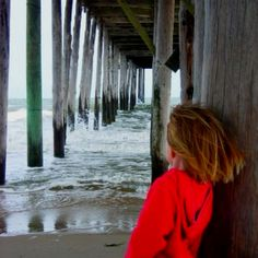 Under the pier in Ocean City, MD appreciating the waves