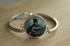 Handcrafted Batman bracelet.  Made by hand from a Justice League comic book. I use all the pages from the book that I can and recycle the rest.