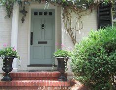 white house, black shutters, blue grey door- open, welcoming