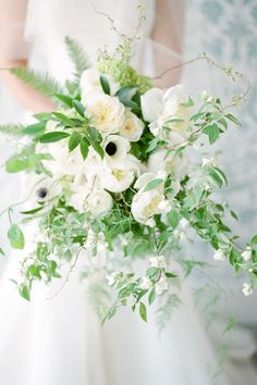 Anemone, rose and ranunculus wedding bouquet: Photography: Brklyn View Photography - www.brklynview.com   Read More on SMP: http://www.stylemepretty.com/2016/10/19/spring-brooklyn-wedding-filled-with-cherry-blossoms/