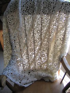 Repeating rows of lace crocheted in a beautiful heirloom blanket. (Patons Yarns)