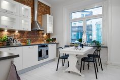 white kitchen w/red brick