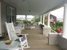 I would love to have a wrap around porch like this.