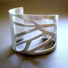 Large Silver Cuff with Geometric CutOuts Pattern by ToTheMetal, €140.00