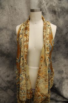 Turn a large scarf/pashmina into a vest?  I may have to try this.
