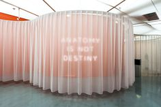 """mostra """"Femme/Objet"""" al MAM di Parigi - I love this. Text behind a curtain. Very theatrical, for all it tells and all it denies. I also love the curved wall as an entrance way, heralding our space."""