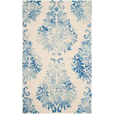 A captivating blend of color and texture, this dip-dyed wool rug showcases a damask print in a blue ombre hue.  Product: Rug