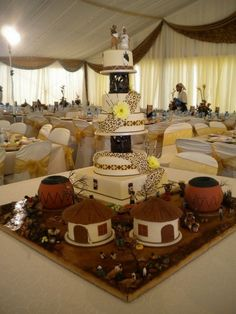 High tower House cake with smaller huts. Cake via South African Cake Decorators Guild African Wedding Cakes, African Wedding Theme, African Theme, South African Weddings, Indian Weddings, Nigerian Weddings, Romantic Weddings, Zulu Traditional Wedding, Traditional Cakes