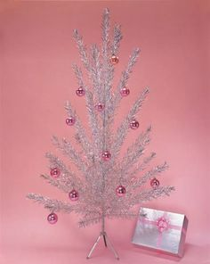 Found my husbands silver vintage tree in the attic a couple of months ago I am SO READY to put it up.  One of the few memories I can recall from my childhood was our silver tree we had!  pink aluminum christmas tree