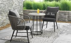 a small patio featuring a wooden 3 piece bistro set Porch Table And Chairs, Round Patio Table, Balcony Chairs, Patio Furniture Covers, Wicker Patio Furniture, Modern Outdoor Furniture, Table And Chair Sets, Wooden Dining Set, Outdoor Dining Set