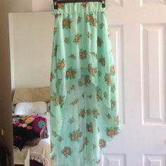 Floral high-low skirt Brand is not Charlotte Russe. Only worn a few times. Chiffon like material. Is lined underneath. Elastic waist band. Best fits a small. Charlotte Russe Skirts High Low