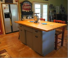 Rusty Metal Cabinet Turned Into Butcher Block IslandLove this . They did an awesome job on it . Also love the shelving hanging on the walls .
