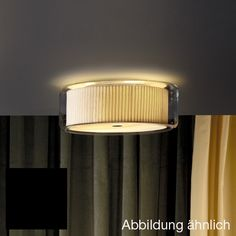 pleated fabric encased in glass.   Marset Mercer C ceiling light A89-061