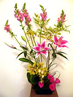 Stargazer lily, orchid, and snapdragon arrangement
