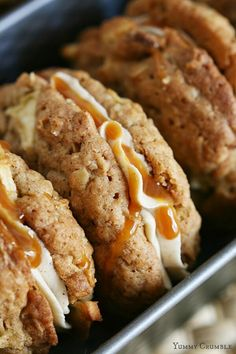 Caramel Apple Cookie Sandwiches: Soft and chewy apple spice oatmeal cookies sandwiched with brown sugar and cinnamon buttercream frosting and drizzled with salted caramel. Think of the perfect caramel apple pie you can eat with your hands!