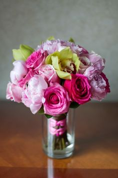 bridesmaids bouquets of pink roses, pink peonies and green cymbidiums - Use purple colors and some pink..splash of blue