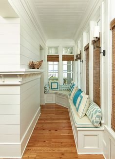 beach house lap board hallway with bamboo and built in seating via House of Turquoise: Structures Building Company House Of Turquoise, Luxury Interior Design, Home Interior, Farmhouse Interior, Vintage Farmhouse, Building Companies, Built In Bench, Bench Seat, Ship Lap Walls