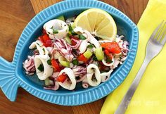 A light refreshing seafood salad made with squid, fresh lemon, celery, red onion, roasted peppers, garlic and parsley.  It's sweltering outside, the temperature in New York is expected to hit over a 100 degrees today. We are getting some work done to my house and unfortunately I have no AC at the moment so I wanted to make something cold and refreshing without heating up the house and this cold calamari salad is exactly what I was craving. If you buy your squid cleaned, this takes minutes…