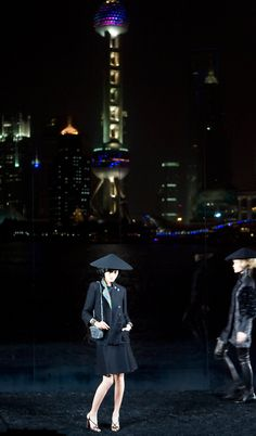 ELLE loves... A model wears a black two-piece suit in the Pre-Fall 2010 Chanel fashion show, that took place in Shanghai in front of the famous Oriental Pearl tower.