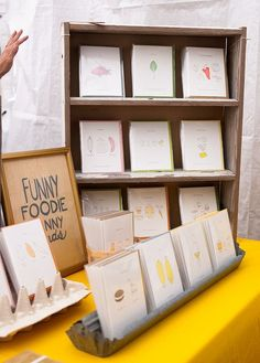 Cool trays to prop handmade cards up in and good use of a small cabinet to add height