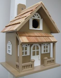 The Country Cottage Birdhouse in different color for your home. Constructed of…