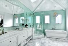 Bathroom. Bathroom with floor-to-ceiling seafoam glass subway tiles. #Bathroom