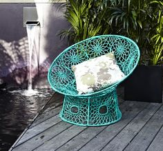 Aqua wicker chair.  I would love to own something like this, but I would be afraid I would crush it - it looks so delicate!