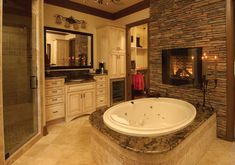 51 Mesmerizing master bathrooms with fireplaces II Not sure why one needs a fireplace in the bathroom, but hey if I had money to burn...