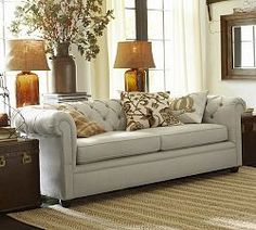 "Chesterfield Sofas & Tufted Sofas | Pottery Barn - you could consider a PB sofa but perhaps upgrade to a family-centric family - at 74"" could be a good fit."