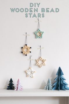 HOW TO MAKE WOODEN BEAD STAR CHRISTMAS DECORATIONS. Deck the halls with these simple diy wooden bead star decorations. They make the prettiest decorations to hang on your tree and with a bit of practice you'll be able to make one in just a few minutes. Diy Xmas, Diy Paper Christmas Tree, Diy Christmas Decorations Easy, Christmas Origami, Noel Christmas, Christmas Porch, Christmas Tree Ornaments, Holiday Crafts, Homemade Decorations