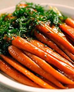 Brown Sugared Carrots -Side - Martha Stewart olive oil, carrots with tops, salt, pepper, light-brown sugar, molasses, grapeseed oil, butter, rosemary