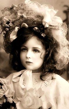 She looks like a doll.
