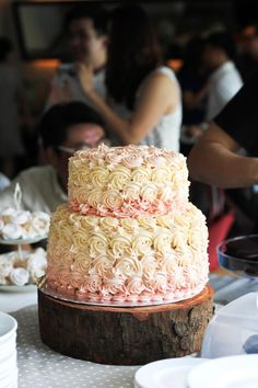 Beautiful pink and cream cake with rose swirls