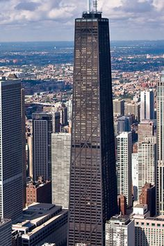 """Hancock Tower, Chicago.  I have been to the top.  I hated it.  Probably should not be on my list of """"Loves."""" Why?  I am terrified of heights.  If you like heights, it is probably awesome.  I had to sit down on the floor  in the elevator.  I can not do Sears Tower.  And have no desire to do so.  Ever.  Bummer...."""