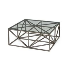 Simple and unique, the Lourve Coffee Table is geometric in design.  Solid in form, it is visually handsome without commanding to much attention.  Dimensions: 40