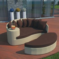 Taiji Daybed in Tan Brown, Tan Brown - Harmonize inverse elements with this radically pleasing daybed set. Seven plush throw pillows adorn Taiji's thick all weather cushions allowing for the splendorous blending of mediating elements. Find the key to attainment as you bask in a charged and unified landscape of expansiveness. Set Includes: One - Taiji Outdoor Wicker Patio Daybed  One - Taiji Outdoor Wicker Patio Ottoman Seven - Taiji Outdoor Wicker Patio Throw Pillows. Material: Synthetic…