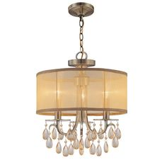 Crystorama's very popular Hampton Collection offers fashion forward designs with soft crystal accents. The Gold Silk Shimmer shade along with the antique brass finish allows this collection to fit any transitional to contemporary room.