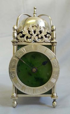 Antique Asprey solid silver and moss agate mantel clock in form of a lantern clock. - Gavin Douglas Antiques