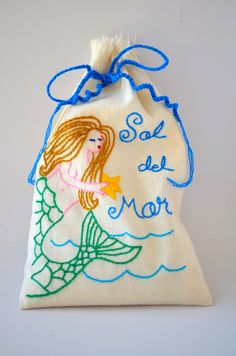 Take this to your Fourth of July BBQ as a hostess gift. The Sal del Mar gourmet sea salt is packaged in a hand-embroidered bag.