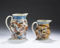 BRITISH CREAMWARE MOCHAWARE SLIP-MARBLED AND 'DENDRITIC SEAWEED' JUG, 1790-1810; AND A PEARLWARE SLIP-MARBLED PITCHER, 1800-20.