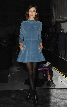 Celebrities at Fashion Week Fall 2015 - Alexa Chung - The model traded her typical denim for a corduroy dress while watching the House of Holland show.