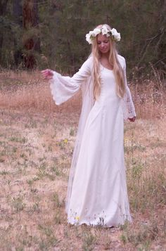 Wedding dress inspired by early 70's Back to Nature movement. Would blend nicely with a rustic wedding. I kinda like this theme for a wedding if I have one again, since I was part of that time and love nature.