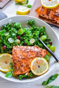 Smokey spicy chipotle and sweet maple syrup glazed salmon, grilled on cedar plank and served with a lite and healthy green kale and grape salad. Sweet, smokey, spicy - gang of three make a dream-co...