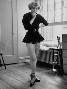 TV Chorus Girl Joan Holloway Rehearsing at Home. by Peter Stackpole