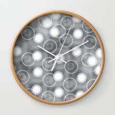 """Available in natural wood, black or white frames, our 10"""" diameter unique Wall Clocks feature a high-impact plexiglass crystal face and a backside hook for easy hanging. Choose black or white hands to match your wall clock frame and art design choice. Clock sits 1.75"""" deep and requires 1 AA battery (not included). Wall Clock Frame, Bubble Wall, White Frames, Unique Wall Clocks, Natural Wood, Bubbles, Hands, Deep, Black And White"""