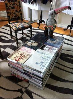 DIY Coffee Table:  Stack books, & top with a slab of acrylic, easy.